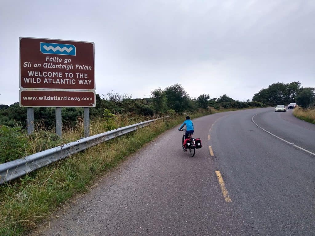 Cycling past big welcoming sign to the Wild Atlantic Way