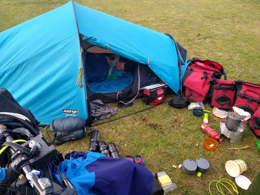 R fast asleep in tent cuddling Bluebell